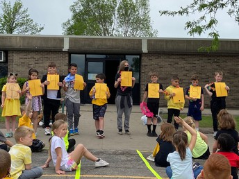 Creating our total from the walk-a-thon $14,143.81