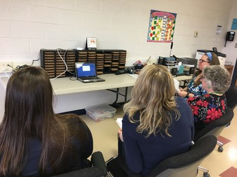 A team of teachers video conferencing with the University of Notre Dame.