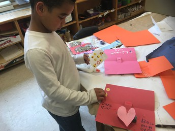 Making a Valentine for his Mom