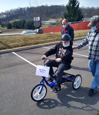 Dylan enjoying his custom fitted bike!