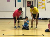 Susitna student shows the class the wrist carry.