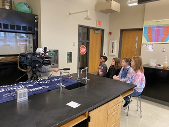 Regional Science Bowl Champs being interviewed.
