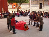 Children doing CAGA TIÓ at school