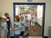 Here come the fourth graders into the gym!