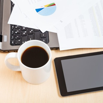 Laptop, tablet, and cup of coffee