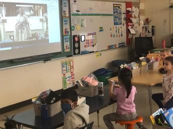 Kindergarten enjoying the virtual Easter mass.