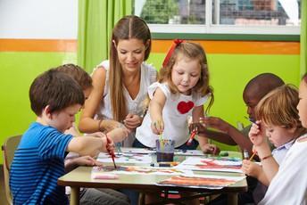 Caregiver working with children