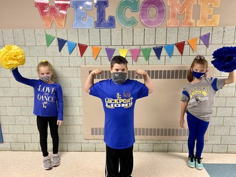 Students Dressed in Blue and Gold