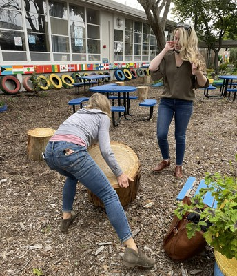 Mrs. Stewart and Mrs. Lung arranging our outdoor learning spaces with tree trunk stumps