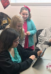 5th Grade Assists High School With Coding