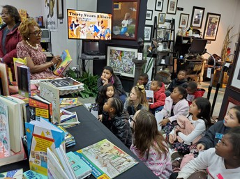 Reading to students enrolled in the Gaston County Schools' A. S. P. I. R. E. Program.