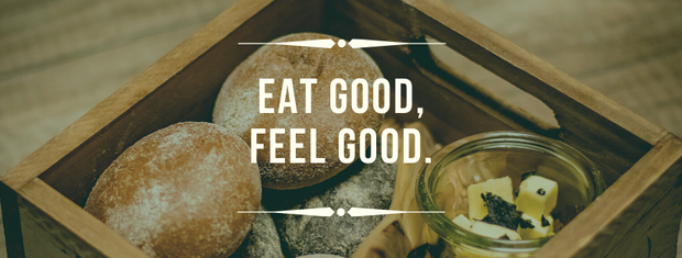 Eat good, feel good.  Image of bread in a wood box.