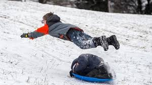 Boy flying off of sled