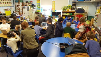 Middle Schoolers helping the Kindergarten class with coding