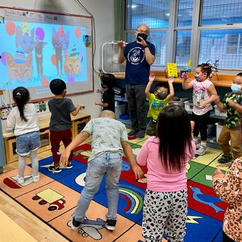 The class dances to a cat video.