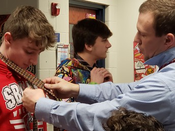 Learning to tie a tie.