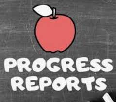 progress reports written on black board including image of red apple
