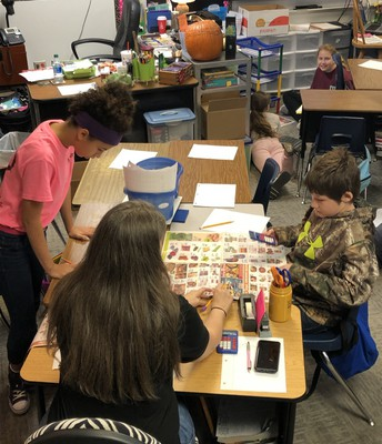 Mrs. Fleming teaches students to shop for Thanksgiving Dinner