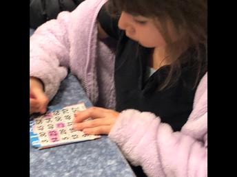 1st Grader Filling Out BINGO Card!