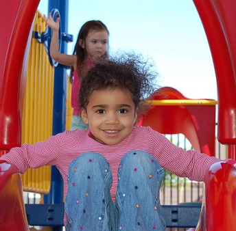 Pre-Kindergarten girl on slide