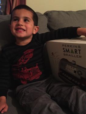 Owen and his Perkins Smart Brailler