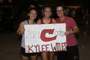 Kylee Wiles with coaches Meads and Johnson