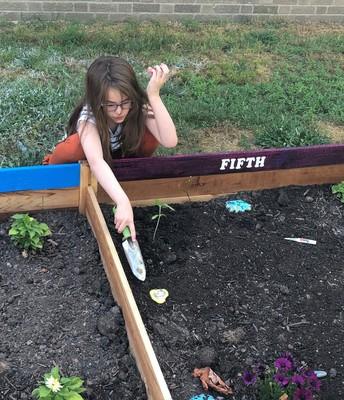 Planting a sunflower for her Prayer Partner