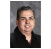 Mr. Adrian Garza - TK