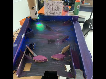Pinball machine made out of cardboard controlled by Hummingbird robotics.