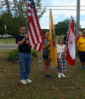 Mr. Sprague, Lily, and I held the flags.