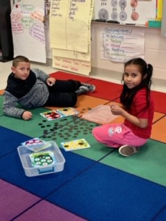 These 2nd grade students were playing a math game during the Guided Math block.