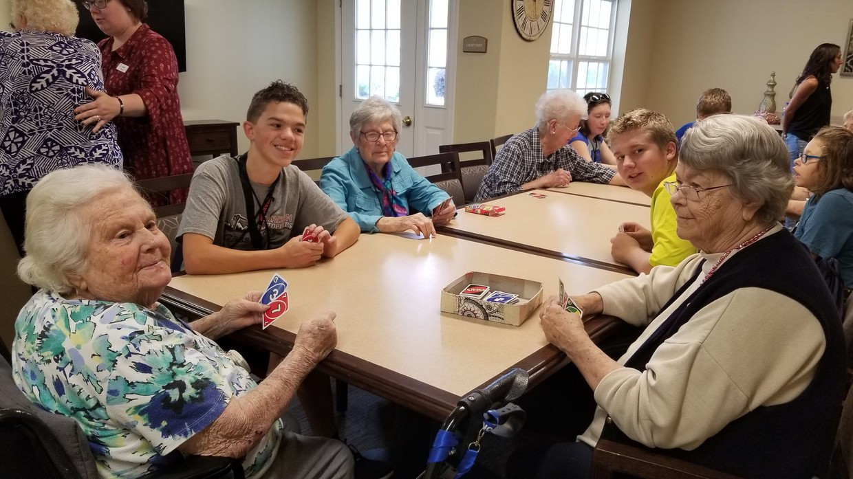 Chardon High School students from Mrs. Amanda Bunker's class spend time on October 2 playing Uno at The Residence of Chardon, an assisted living facility.