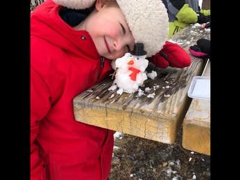 Making mini snow people in Kindergarten