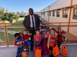Dr. Haggins Trick or Treating with our Little Spartans