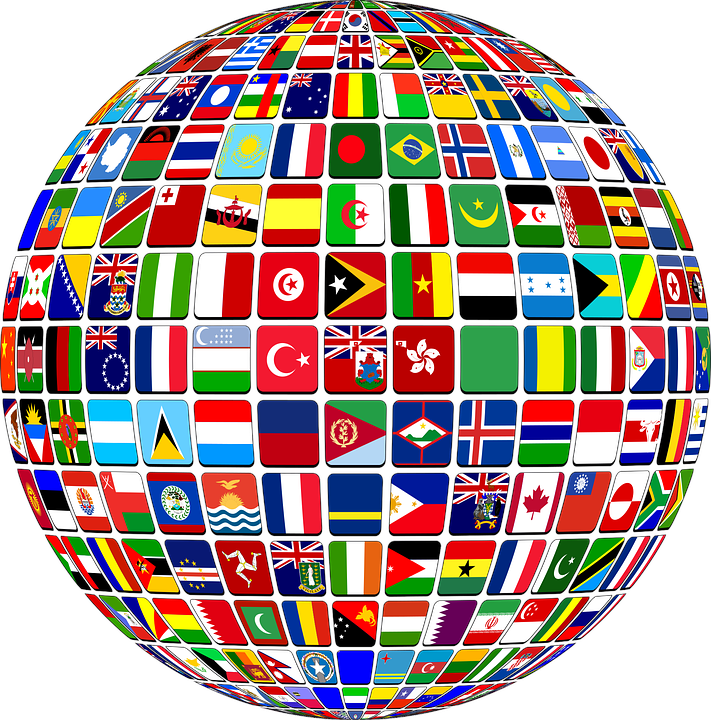 picture of globe representing world with different flags