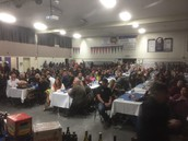 A packed house enjoy dinner and silent auction...
