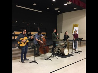 Jazz band playing for a student group