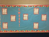 Students of the Month Bulletin Board in the 8th grade hallway