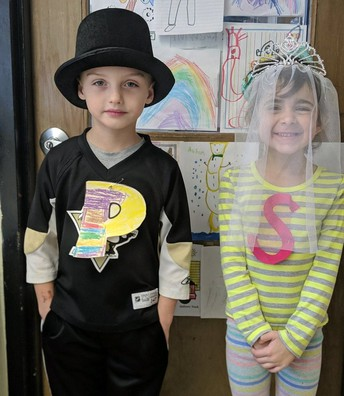 "Mrs. Kingzett's Munson Elementary Kindergarten students representing the letters ""P"" and ""S"" attend the wedding for the letters ""Q"" and ""U""."