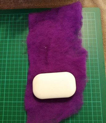 Take the fluffy batting and wrap one layer around the soap bar tightly.