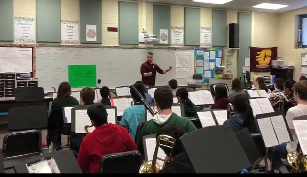 Mr. Ronning directs the middle school band in his classroom