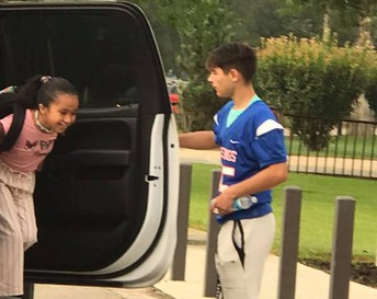 Football Players Welcoming Students on the First Day