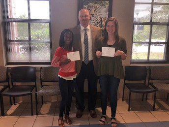 NHS Commended Scholars Hannah Irby and Samantha Savage pose with principal Kyle Ferguson.