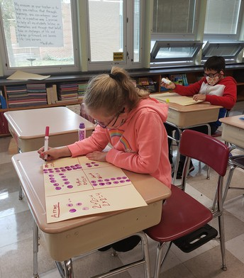 Students creating math arrays.