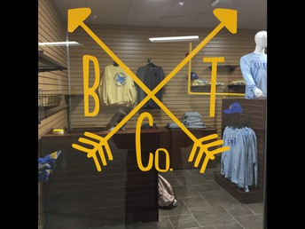 buffalo trading company logo on door to the new school store for spirit items