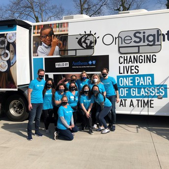 OneSight team posing in front of mobile lab