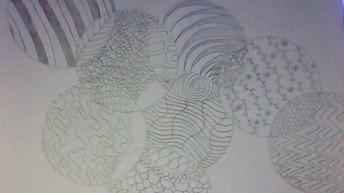Black & white drawing of zen circles