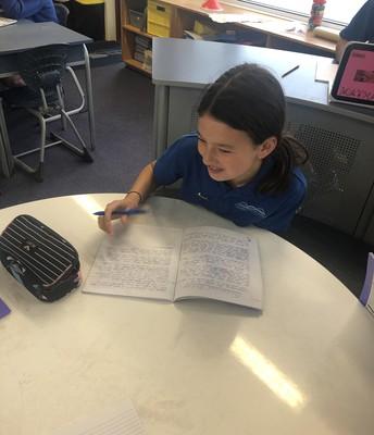 Olivia busy writing!