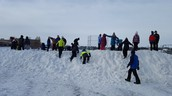 The snow hill is a big draw at recess