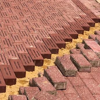 Engraved bricks on ground